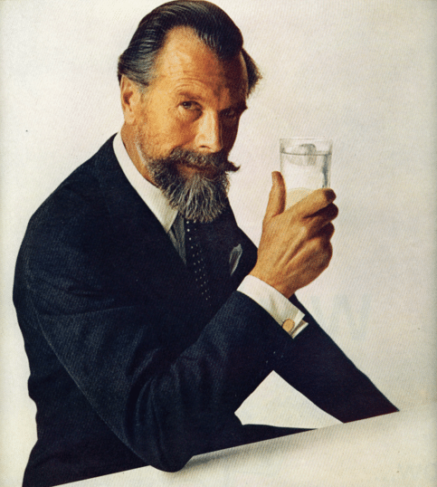 Commander edward whitehead portrait holding glass of water.