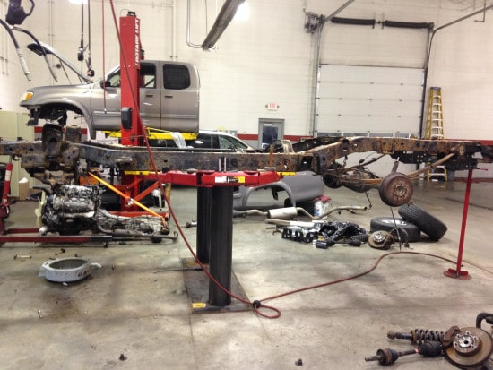disassembled truck in auto body shop getting repaired