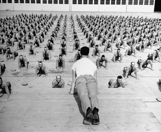 vintage army military squad doing push-ups