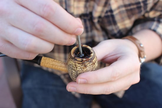 tamping pipe tobacco with nail corn cob pipe