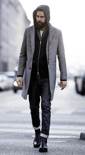 hipster wearing gray overcoat over hooded sweatshirt