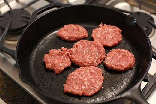 cooking sausage patties cast iron skillet breakfast sandwiches