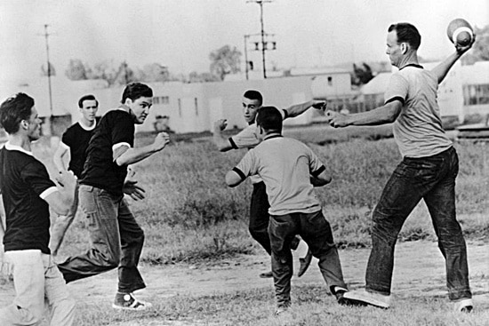 vintage young men playing pick up backyard football