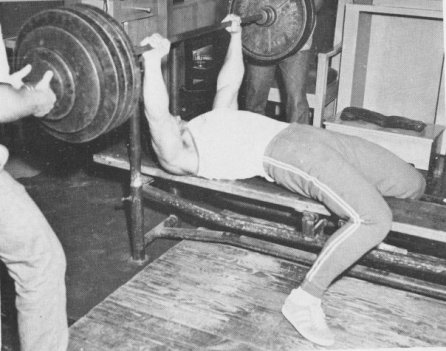 vintage man doing bench press weightlifting