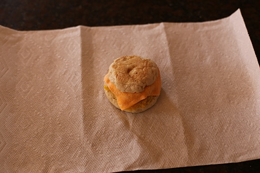 frozen homemade breakfast sandwich on paper towel