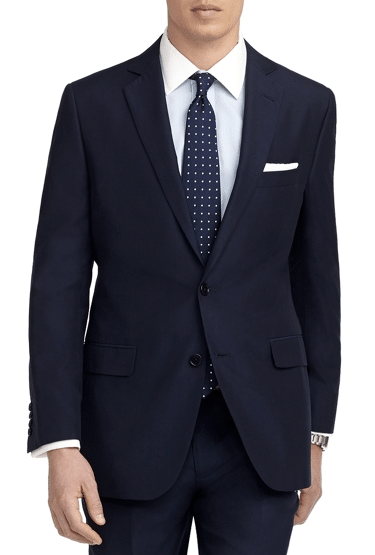 A navy blue suit with polka dot tie.