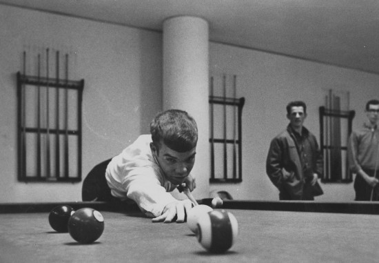vintage man playing pool billiards photo from table