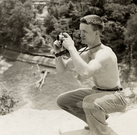 vintage man kneeling shirtless taking photographs photos