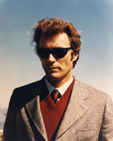 young clint eastwood blazer sweater sunglasses serious look