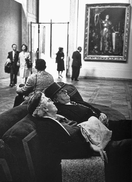 Vintage old couple napping in art museum.