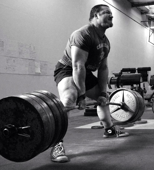 chris duffin powerlifter deadlifting straining black white photo