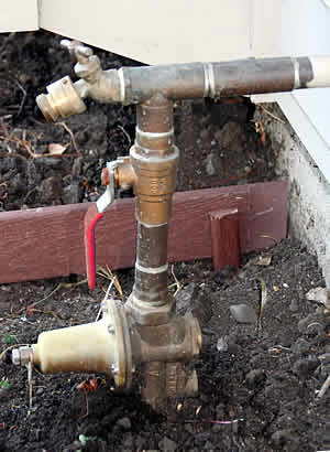 A typical outdoor main water shut off.