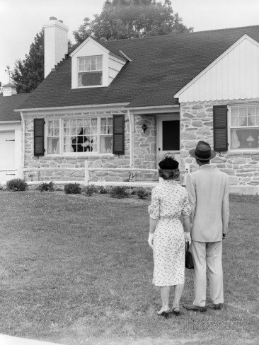 vintage couple in yard looking at new home