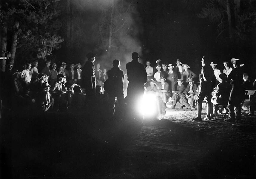 vintage group of men around campfire