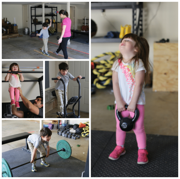 little kids playing in home gym lifting weights