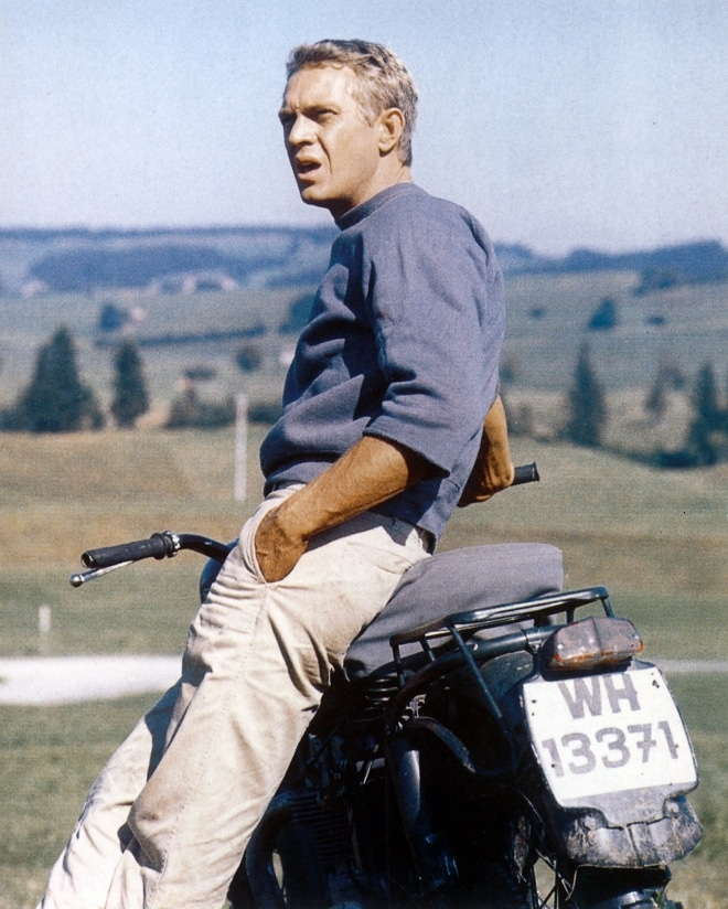 steve mcqueen great escape movie leaning against motorcyle
