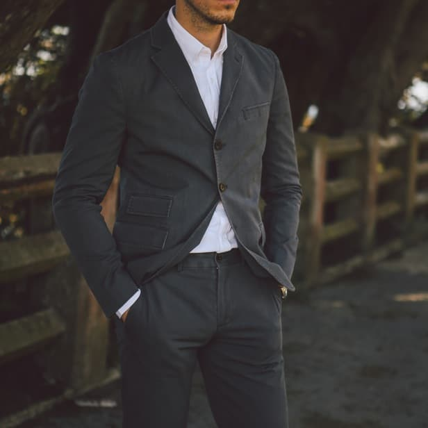 Man wearing a matching blazer with pant.