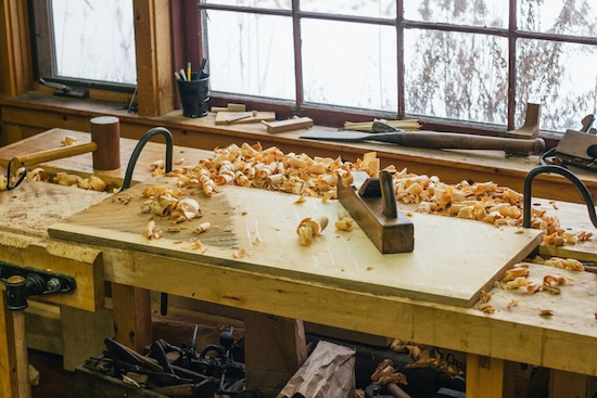 lumber in workshop with hand plane