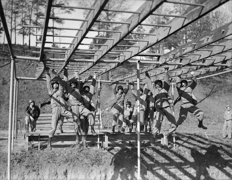 vintage boot camp basic training soldiers doing monkey bars