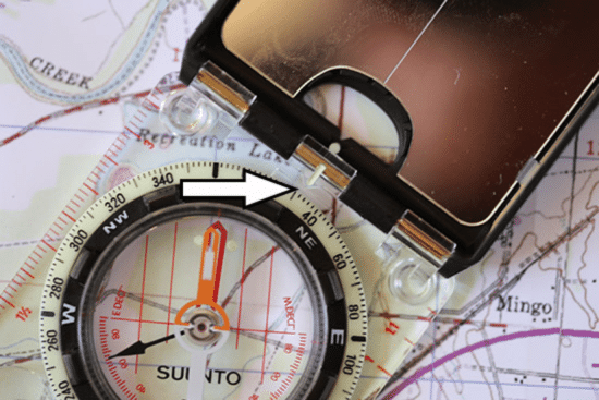 taking a bearing with map and compass close up photo