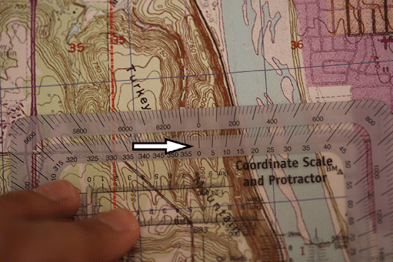 shooting bearings with protractor on topo topographic map