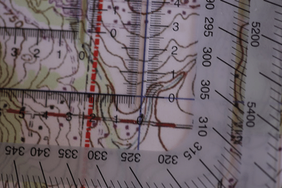 land navigation lining up protractor and topo topographic map
