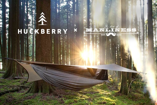hammock camping with rain fly in forest