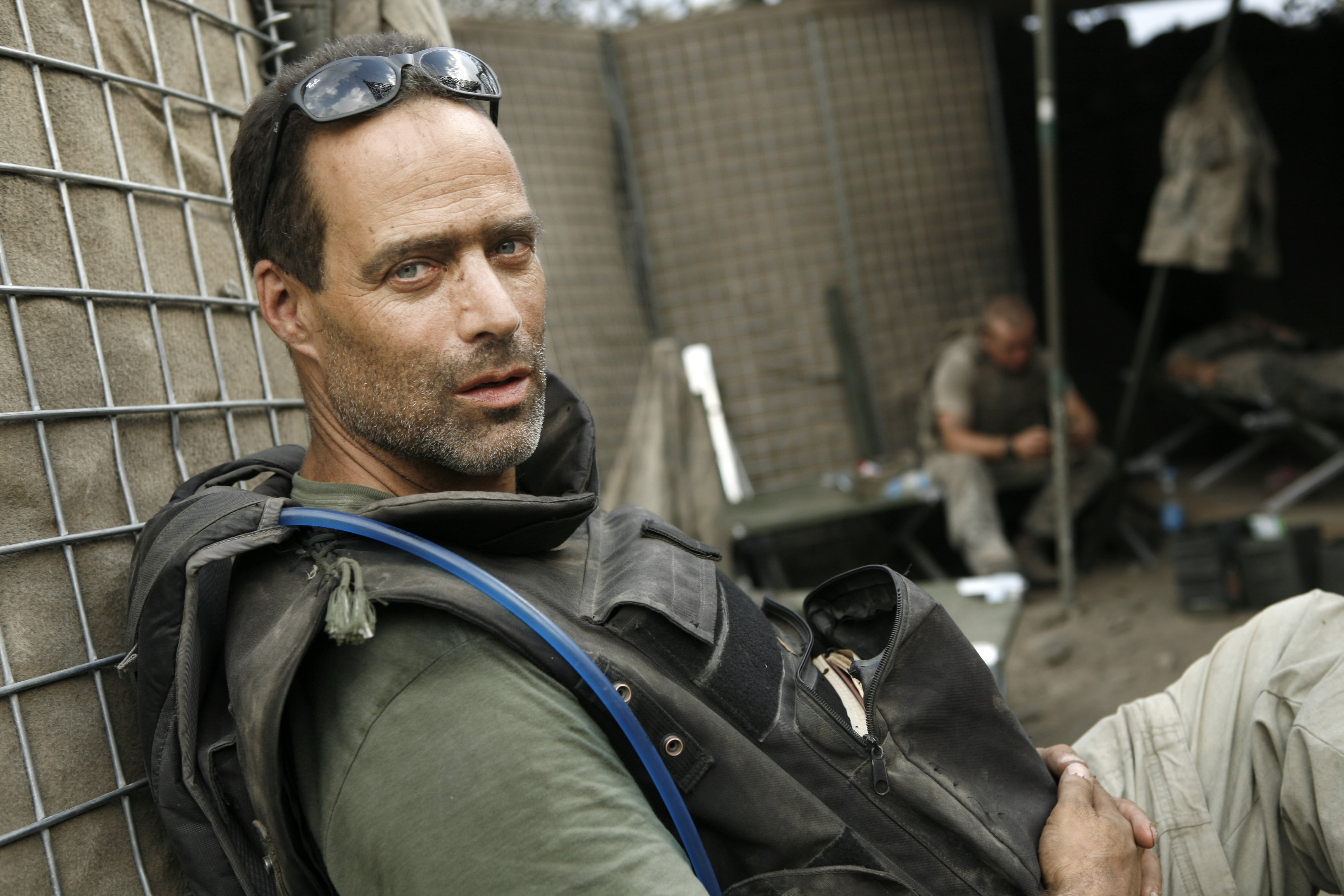sebastian junger in military camp wearing camelbak