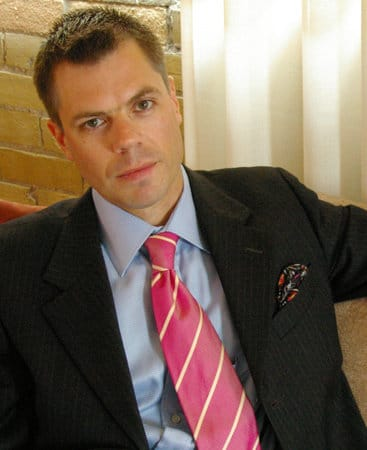 russell smith writer style expert in suit