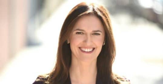caroline webb author businesswoman smiling head shot
