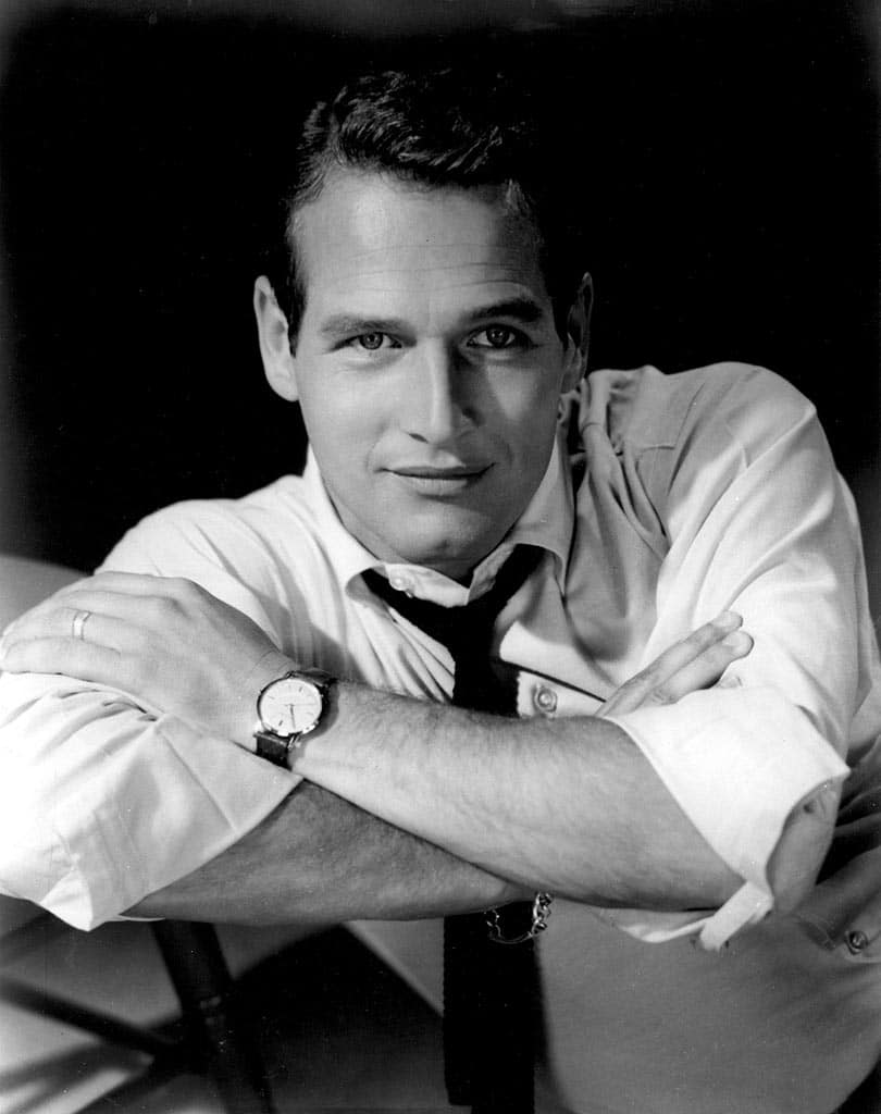 Vintage man in shirt and tie with dress watch on wrist.