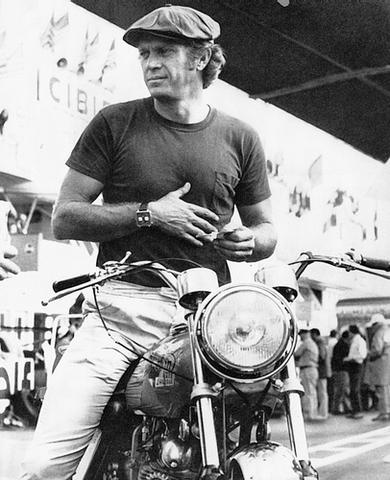 vintage motorcycle wearing racing watch on wrist