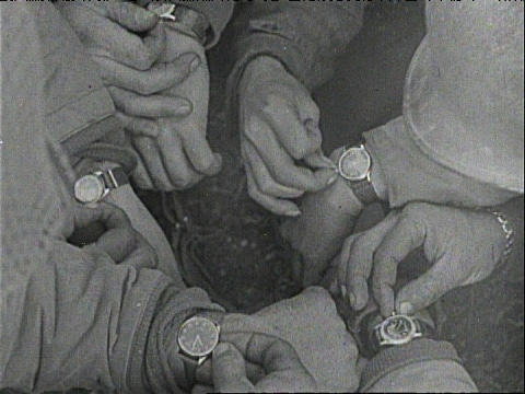 vintage Soldiers syncing their watches during WWII.