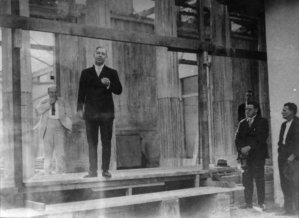 vintage man businessman giving speech in hall
