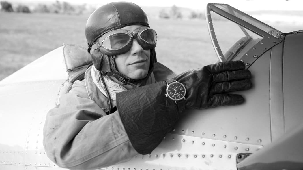 vintage pilot wearing aviator's watch outside leather gloves