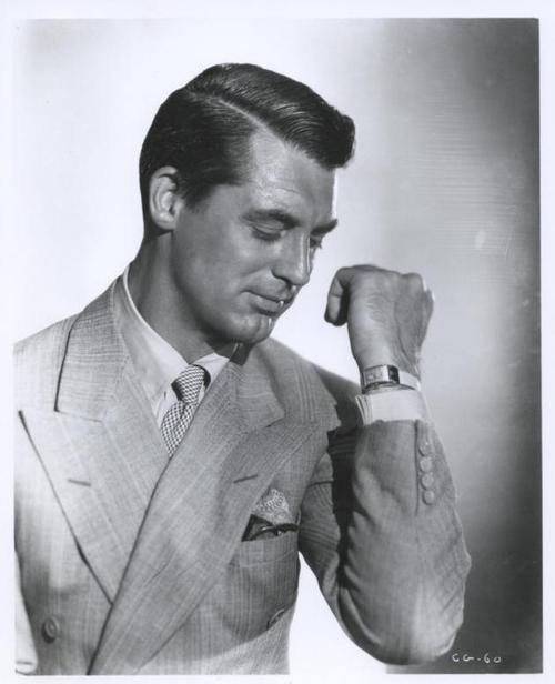 Vintage businessman in suit wearing dress watch wristwatch.