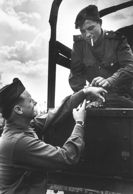 vintage soldiers looking at admiring watch wristwatch