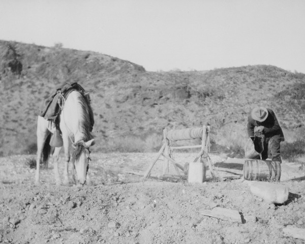 Vintage man with horse in desert.