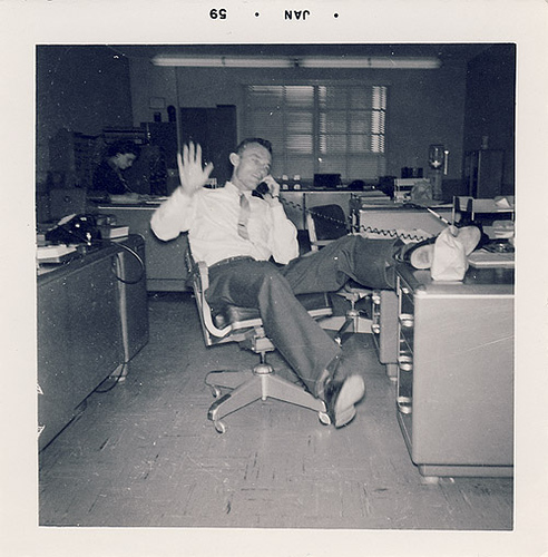 vintage 1950s man on phone at office