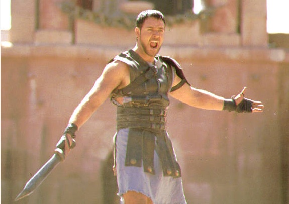 Russell Crowein giving pose in gladiator shooting.