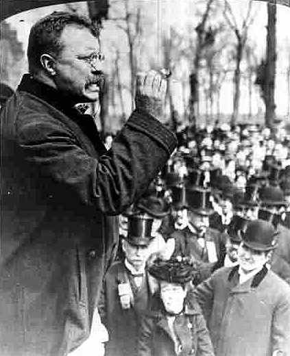 Vintage Theodore Roosevelt giving speech to people.