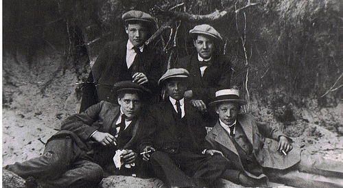 Vintage group of young men wearing flat cap.