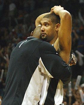 Tim Duncan NBA being hugged in a match.