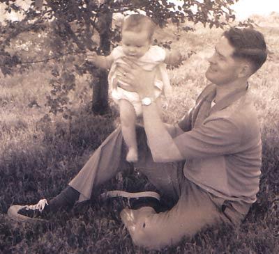 Vintage man holding baby.