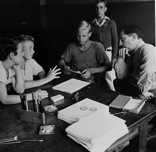 Vintage students in school with teacher.