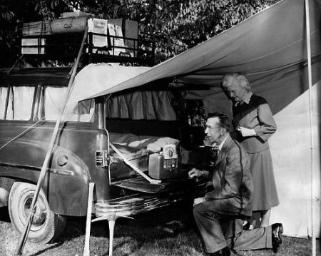 Vintage couple enjoying car camping.