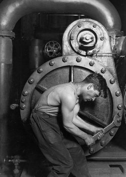 Vintage man using mechanic wrench.