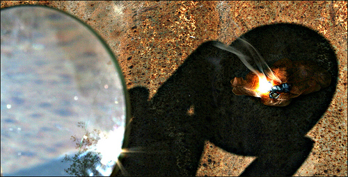 Burning a fire from mangnifying glass.