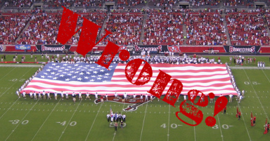 Giant American flag on a football field.