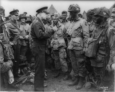 Dwight D Eisenhower giving instructions to soldiers in battle.